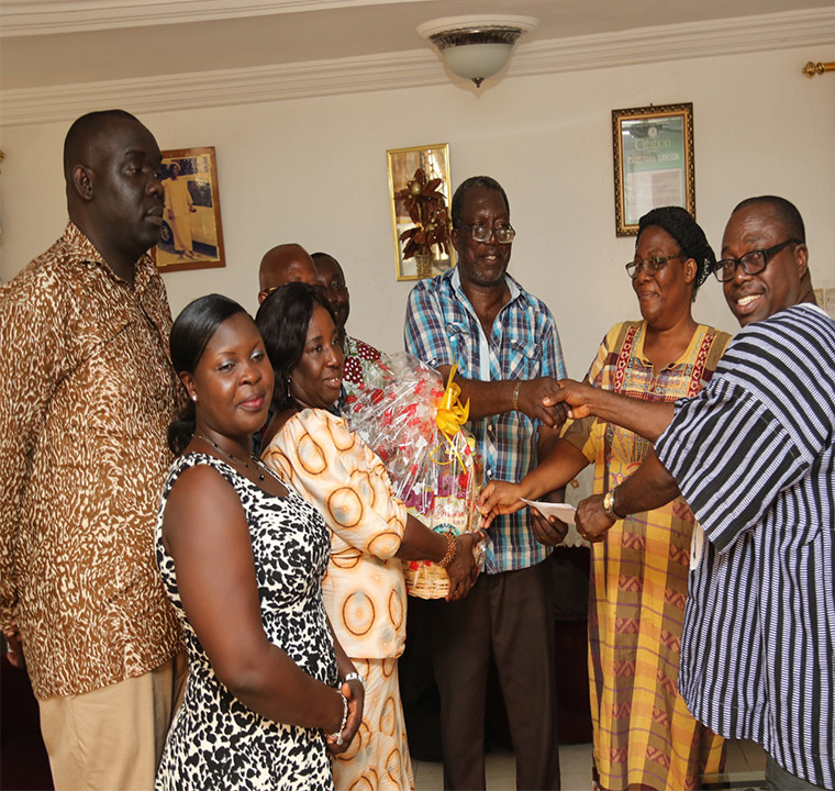 The team presenting a hamper to Mr. Daniel Turkson, formerly of the Documentation and Information Section