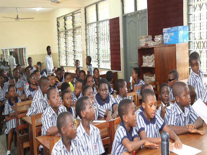 Pupils of the University Primary School listening to the presentation